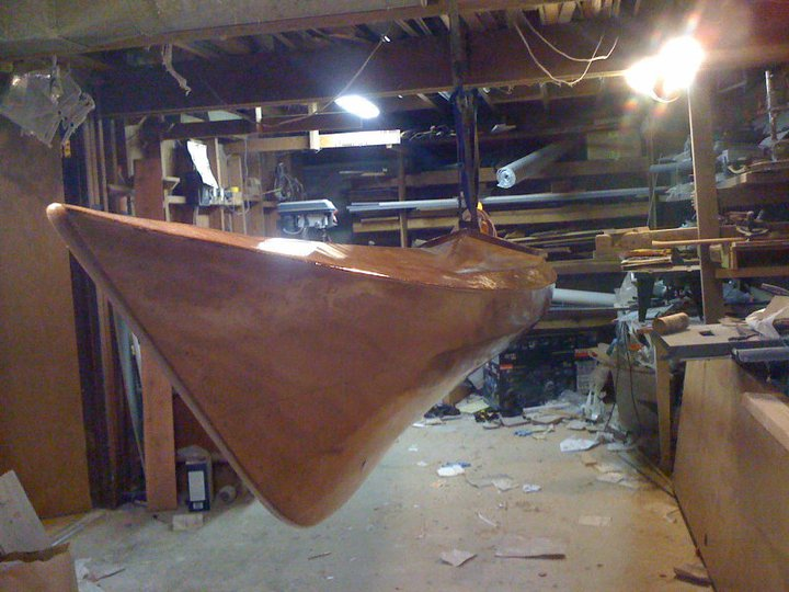 Building a wooden kayak: Deck and hull attached.